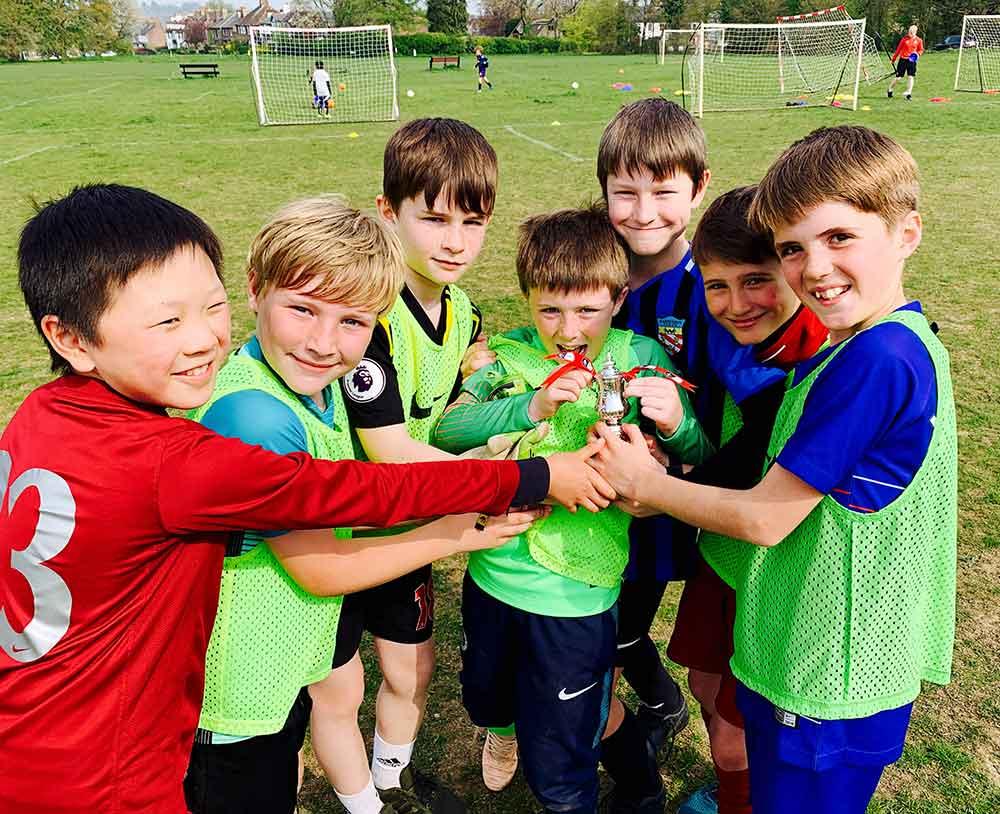 Stay Campus London Watford FC English & Football Academy Young Boys Celebrating Trophy Training
